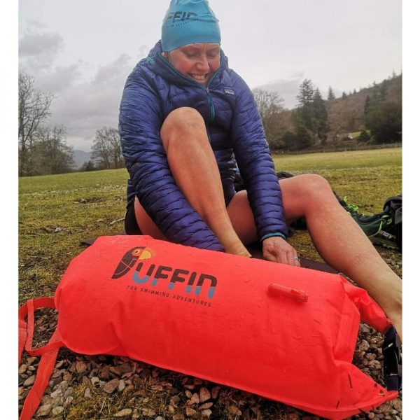 lady changing after cold water swimming with eco-friendly float