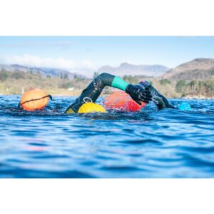 swimmers towing a R28 drybag float whilst swimming in lake